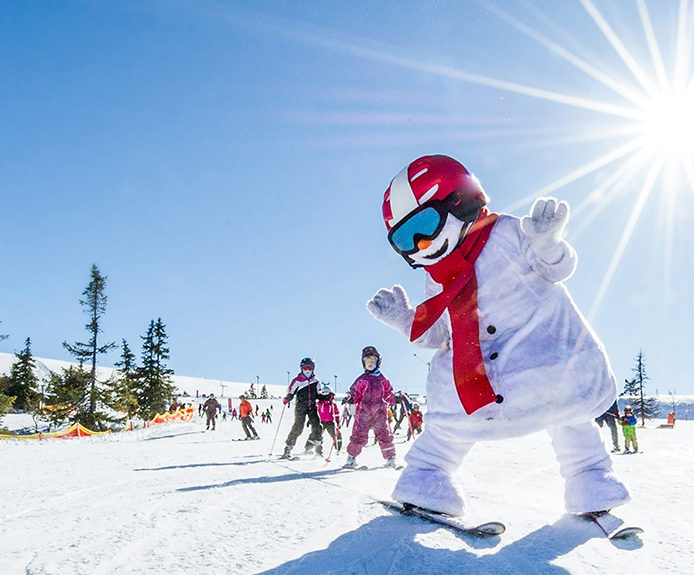 Skiing snowman mascot
