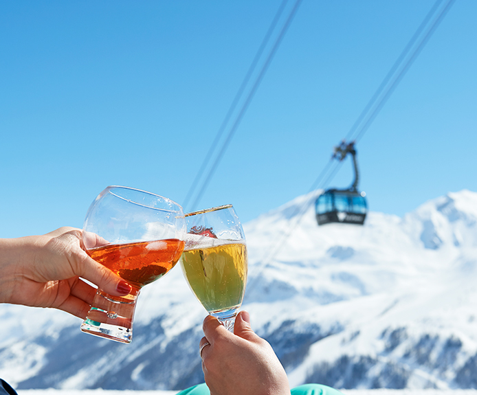 Toasting drinks in a ski resort