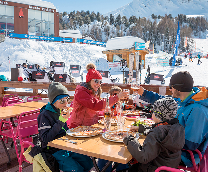 Family eating at a ski resort