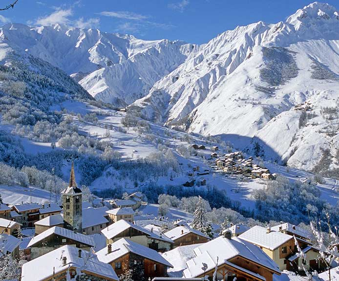 View of St Martin de Belleville village and the French Alps. Crystal Ski Holidays