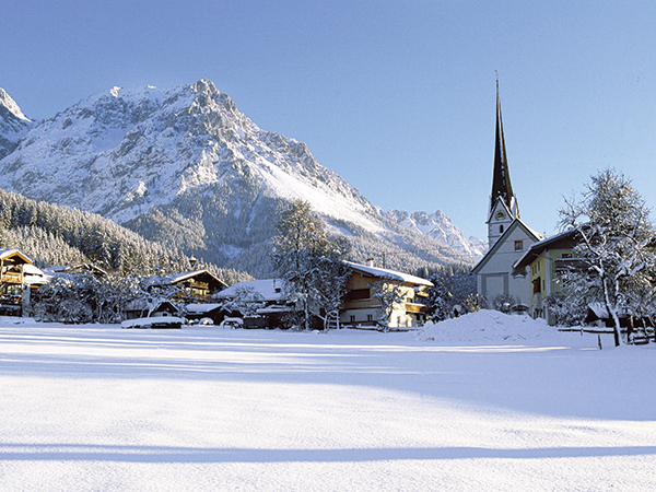 church and snow covered mountain