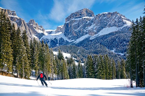 single skier on an empty slope
